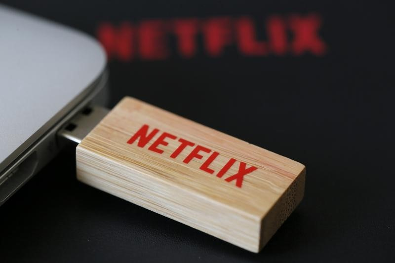 An USB key with the logo of Netflix, the American provider of on-demand Internet streaming media, is seen in this illustration photo, in Paris September 15, 2014. REUTERS/Gonzalo Fuentes
